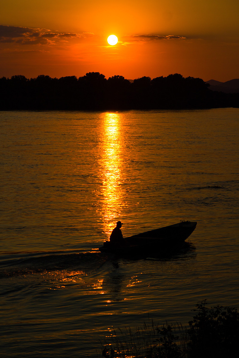 Danube sunset with fisherman