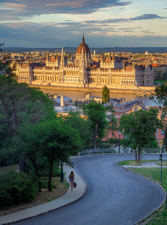 Parliament in the sunset from Fishermens bastion with dog walkin