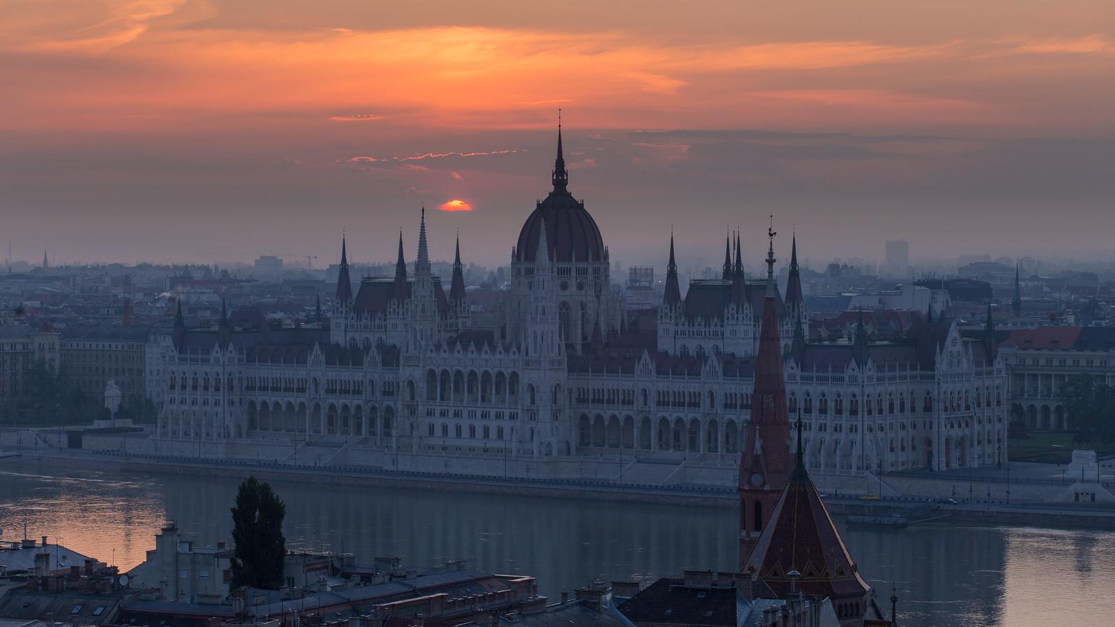 Sunrise behind Parliament Budapest